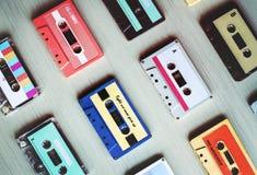 Inzameling van Retro de Bandjaren '80 van de Muziek Audiocassette Stock Afbeeldingen
