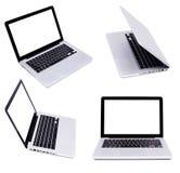 Inzameling van vier zilveren laptops Stock Fotografie