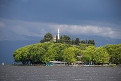 Ioannina city dock and lake Pamvotis in spring rainy day greece. Ioannina city dock and lake Pamvotis in spring rainy day in greece stock photography