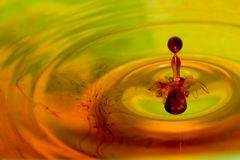 Iodine drop. On water surface Stock Photos