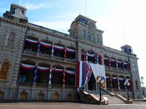 Iolani Palace covered in Hawaii State and Hawaiian Kingdom Flags royalty free stock images