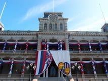 Iolani Palace covered in Hawaii State and Hawaiian Kingdom Flags stock image