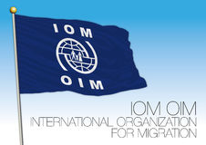IOM, OIM, organisation internationale pour le drapeau de migration Images stock