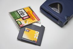 Iomega Zip 250 Drive, Disk and Jewel Case. Iomega Zip 250 SCSI Drive, Disk and Jewel Case on white background Stock Photography