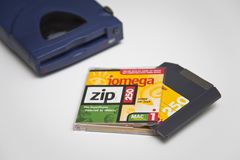 Iomega Zip 250 Drive, Disk and Jewel Case. Iomega Zip 250 SCSI Drive, Disk and Jewel Case on white background Royalty Free Stock Photography
