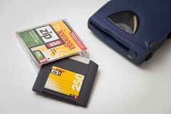 Iomega Zip 250 Drive, Disk and Jewel Case. Iomega Zip 250 SCSI Drive, Disk and Jewel Case on white background Stock Image