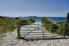 Iona, north-end. The path down through a ramshackle gate to the beautiful white sands of the north end of the island of Iona, Scotland. A popular and picturesque Royalty Free Stock Image