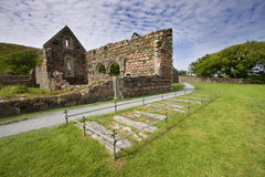 Iona Nunnery Ruins. On the Isle of Iona in the Inner Hebrides on the West Coast of Scotland. The ancient graves in the foreground are of former nuns stock photos