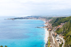 Ionian Sea coastline and Giardini Naxos town Stock Photos
