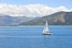 A yacht in Ionian Sea near the coast of Greece, Europe stock photos