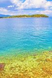 Ionian Sea view Greece. Clear turquoise Ionian Sea water by Corfu island shore .Corfu or Kerkyra is a Greek island in the Ionian Sea. It is the second largest of Royalty Free Stock Images