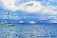 Ionian sea yachts. Cruising vessels in Ionian Sea near Corfu island and mainland Greek coast on the background Royalty Free Stock Image