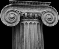 Ionic Capital on black background Royalty Free Stock Images