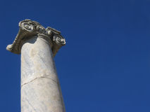 Ionic Column. An Ionic Column in Perge Turkey set against a clear blue sky Stock Photo
