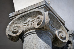 Ionic column capital. Classic ionic style column capital in grey stone royalty free stock images