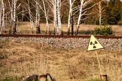 Ionizing Radiation sign near Chernobyl nuclear power plant zone of alienation. Ukraine royalty free stock images