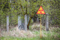 Ionizing Radiation sign. Near Chernobyl nuclear power plant zone of alienation, Ukraine Stock Photography