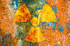 Ionizing Radiation Symbol. A ionizing radiation symbol on rust metal plate Stock Images