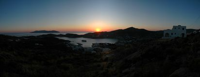 Ios sunset panorama. Greek island of Ios near Santorini Sunset Panorama Stock Image