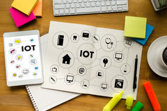 IOT business man hand working and internet of things (IoT) word Stock Images