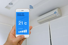 IOT Concept, Remotely Controlling Smart Air Conditioner with App stock image