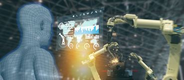Iot industry 4.0 concept,industrial engineer using artificial intelligence ai augmented, virtual reality to monitoring machine i. N real time.Smart factory use stock images