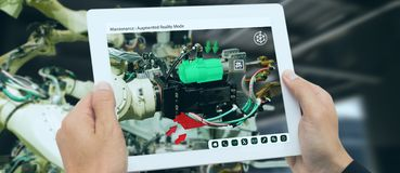 Iot industry 4.0 concept,industrial engineer using software augmented, virtual reality in tablet to monitoring machine in real t. Ime.Smart factory use stock image