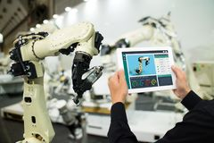 Iot industry 4.0 concept,industrial engineer using software augmented, virtual reality in tablet to monitoring machine in real t. Ime.Smart factory use Royalty Free Stock Images