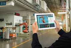 Iot industry 4.0 concept,industrial engineer using software augmented, virtual reality in tablet to monitoring machine in real t. Ime.Smart factory use royalty free stock photography