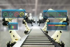 Iot industry 4.0 concept.Smart factory using automation robotic arms with augmented mixed virtual reality technology to show data. With artificial intelligence stock image