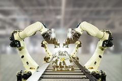 Iot industry 4.0 technology concept.Smart factory using trending automation robotic arms with empty conveyor belt in operation lin Stock Photography