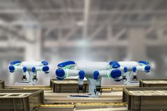 Iot industry 4.0 technology concept.Smart factory using trending automation robotic arms with empty conveyor belt in operation lin. E. Automotive manufacturing Stock Photo