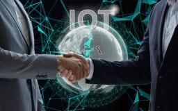 IOT. Internet of Thing concept. Handshake. Businessmen making ha stock photos