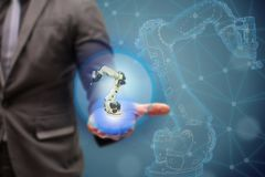 Iot smart factory , industry 4.0 technology concept, Engineer show 3d robot in automation factory background with fake sunlight on. Operation line, Futuristic royalty free stock photo