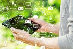 IoT theme with man holding his tablet stock photo