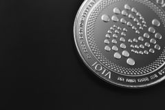 Iota coin logo. Cryptocurrency on the black background royalty free stock images