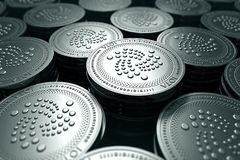 IOTA coins in blurry closeup. New cryptocurrency and modern banking concept. 3D rendering stock illustration