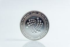 IOTA. Crypto currency silver coin, Macro shot of Iota coin isolated on white background, cut out Blockchain technology, stock photos