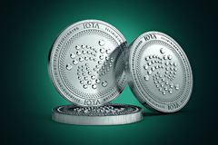 3 IOTA physical concept coins on gently lit green background. 3D rendering. New virtual money stock illustration