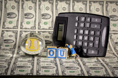 IOU with amoney and calculator and 666 stock photography