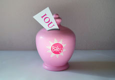 IOU baby savings bank Royalty Free Stock Photo