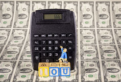 IOU 666 on a calculator with money and man Royalty Free Stock Photos