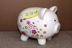Iou i o u piggy bank. Debt Royalty Free Stock Photography