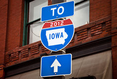 Iowa Caucus 2012 Road Sign. A road sign altered to read 2012 and Iowa inside the state's outlines, representing the 2012 Republican caucuses Stock Image
