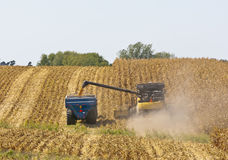 Iowa Cornfields. A combine and a tractor work to harvest a Midwest corn crop in Northeast Iowa stock photos