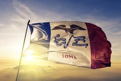 Iowa state of the United States of America flag textile cloth fabric waving on the top. Iowa flag textile cloth fabric waving on the top sunrise mist fog royalty free illustration