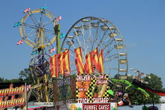 Iowa State Fair: Food booth with rides in background Stock Photos