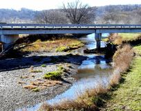 Iowa Stream. The Covered Bridges of Madison County had been preserved as landmarks. As such, alternative bridges over the rivers had to be build. This image is stock image