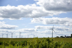 Iowa windmills and farm Royalty Free Stock Images
