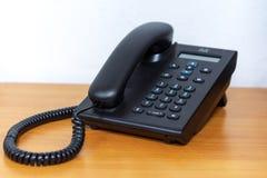IP在木桌上的电话设备 免版税库存照片